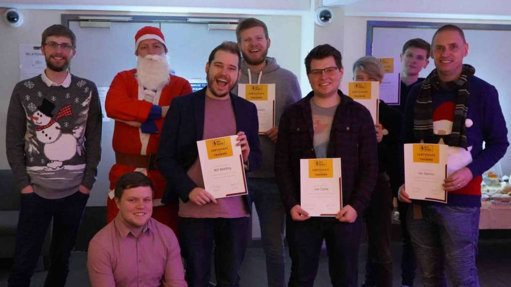 Volunteers holding certificates.